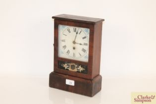 An American mantel clock with white painted Roman