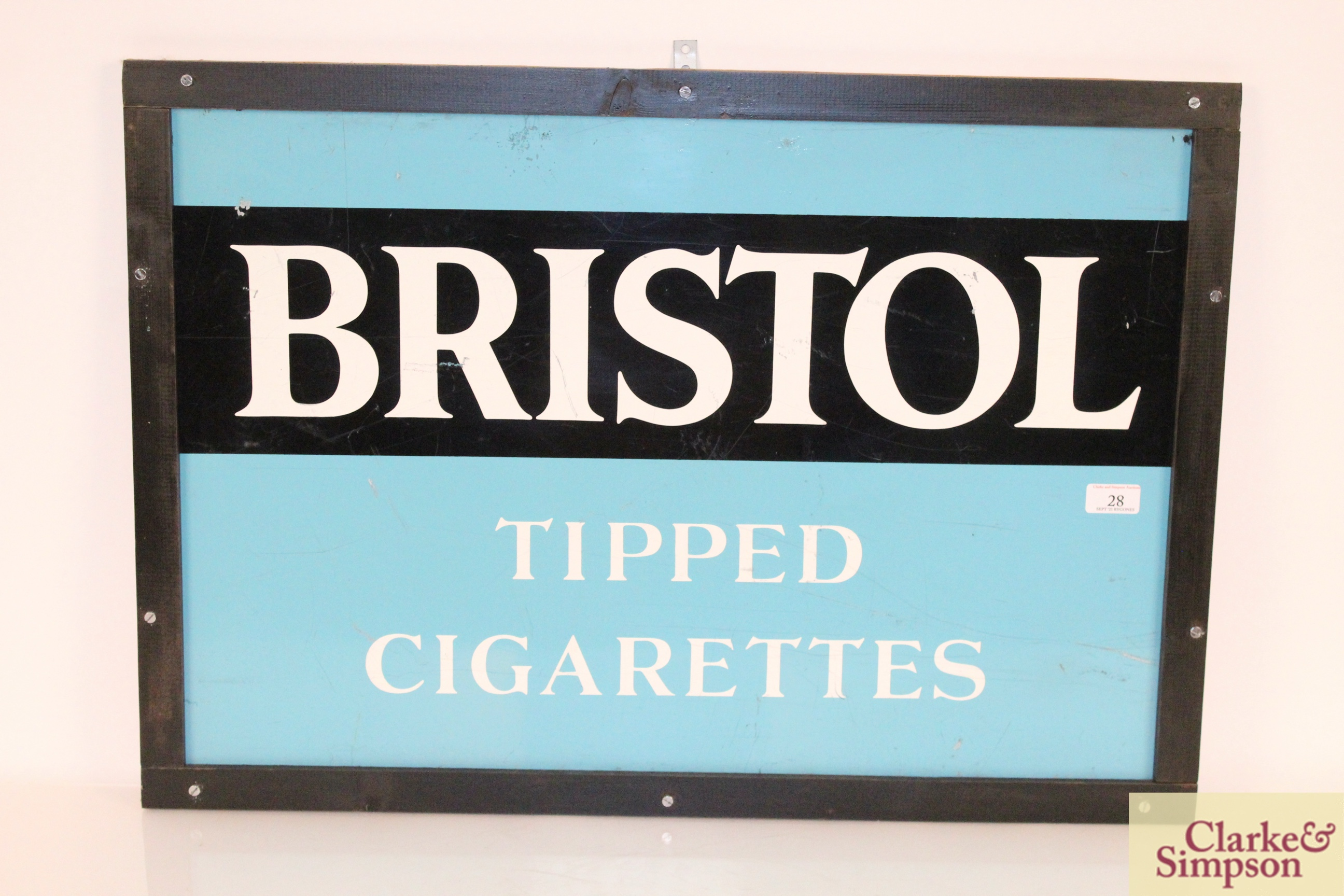 """A """"Bristol Tipped Cigarettes"""" enamel advertising sign,"""