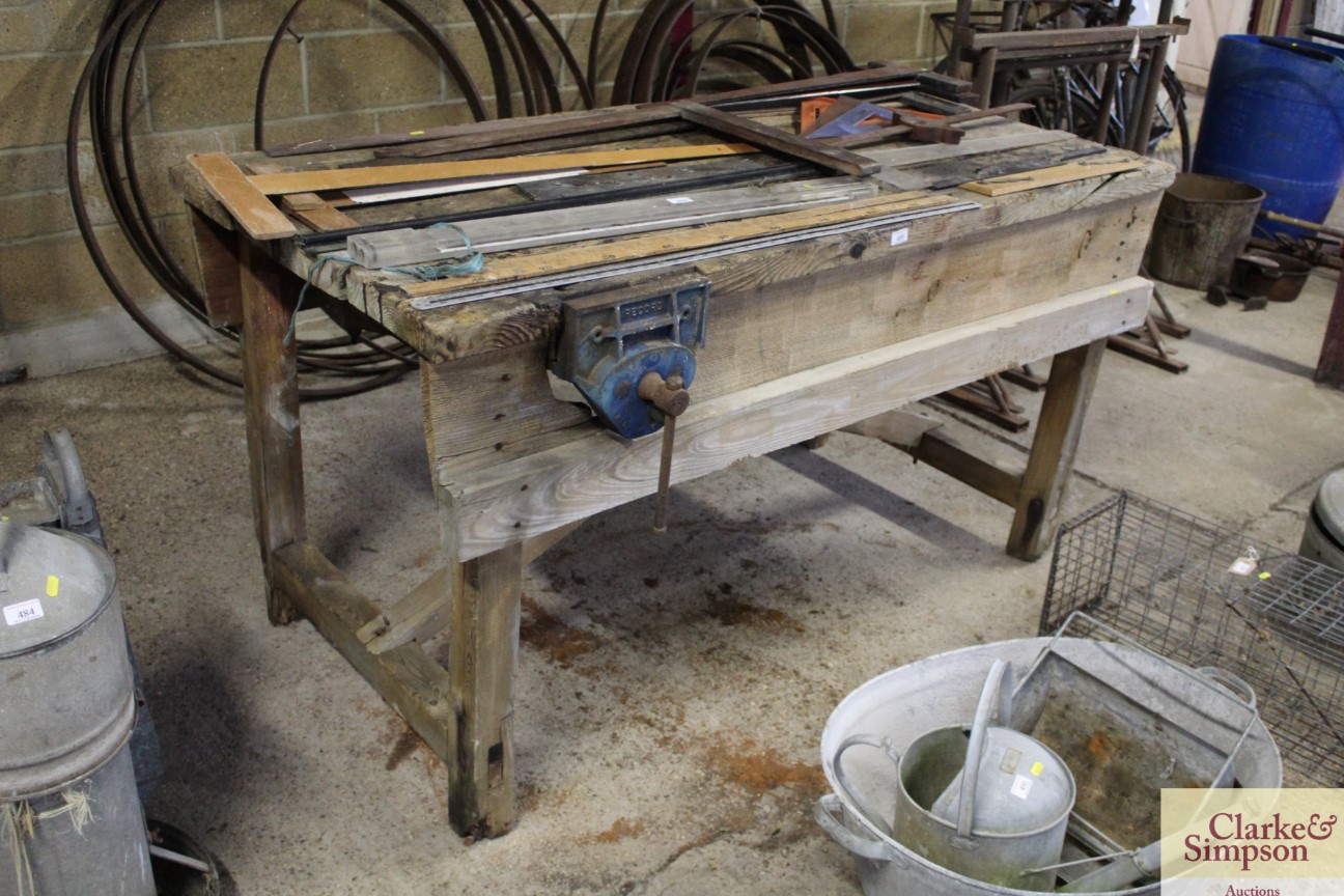 A vintage wooden work bench complete with Record v