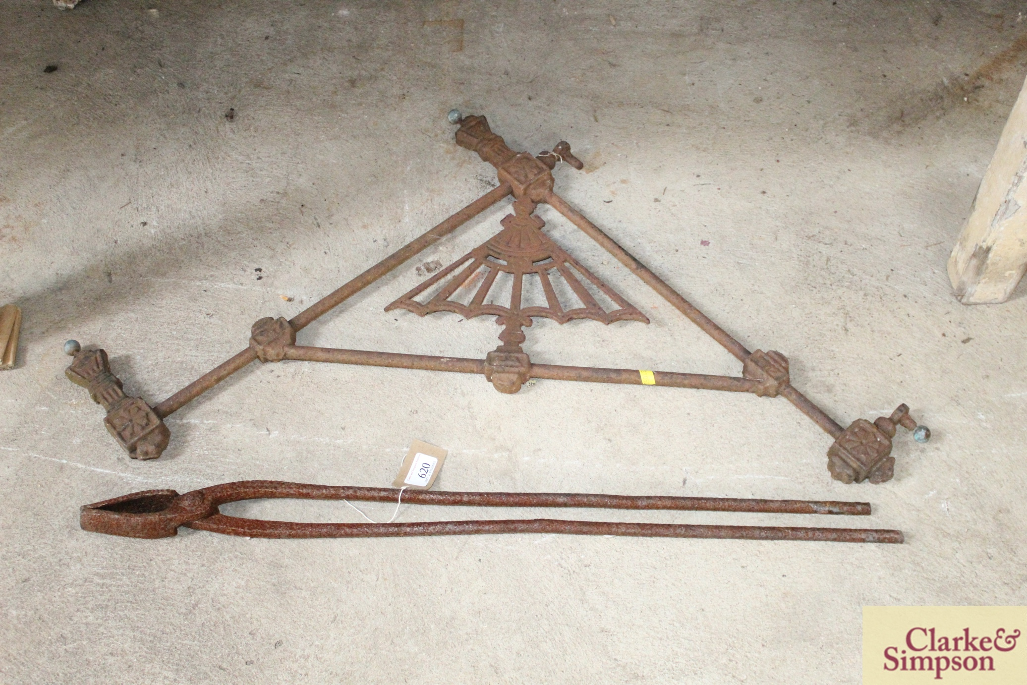 A pair of iron foundry tongs and a decorative iro