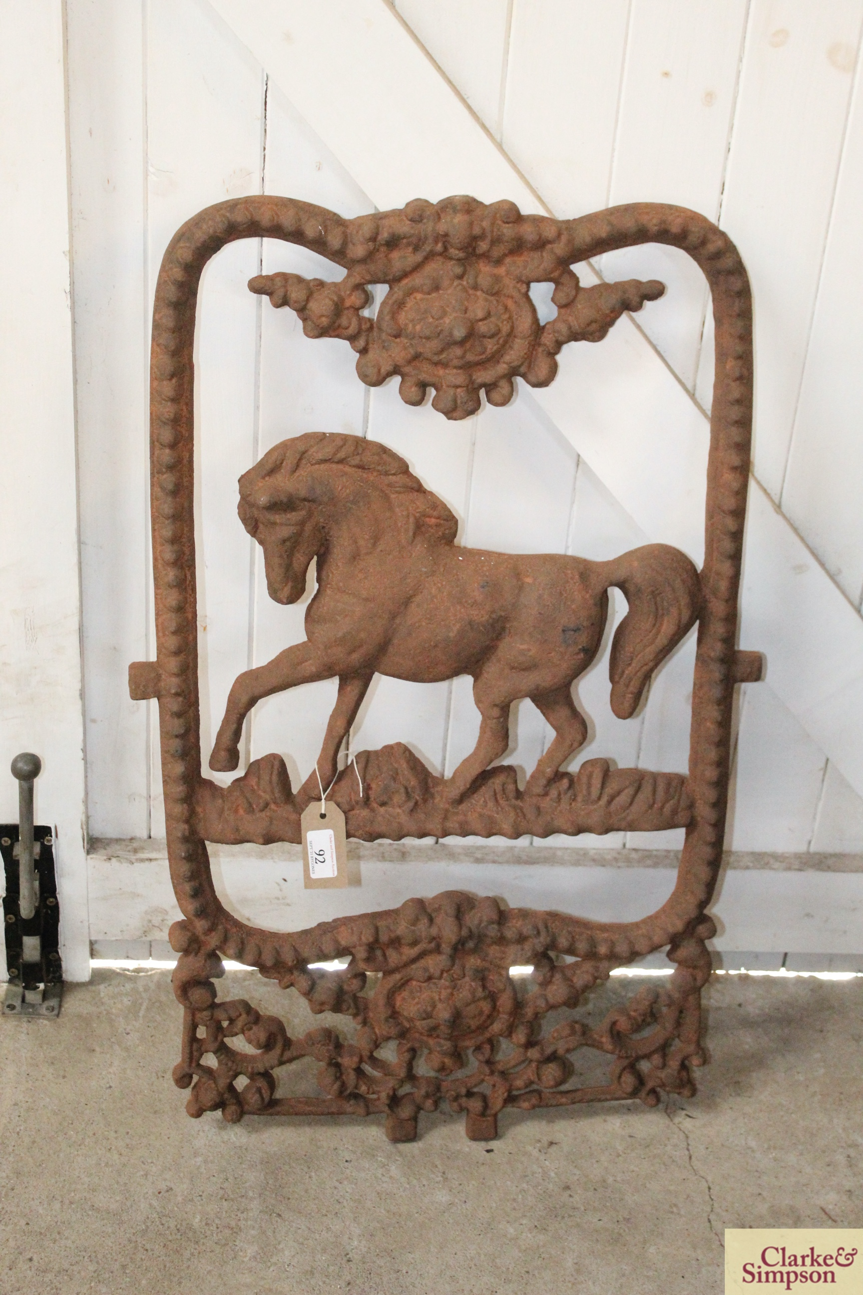 A Victorian style cast iron horse decorated stable windo
