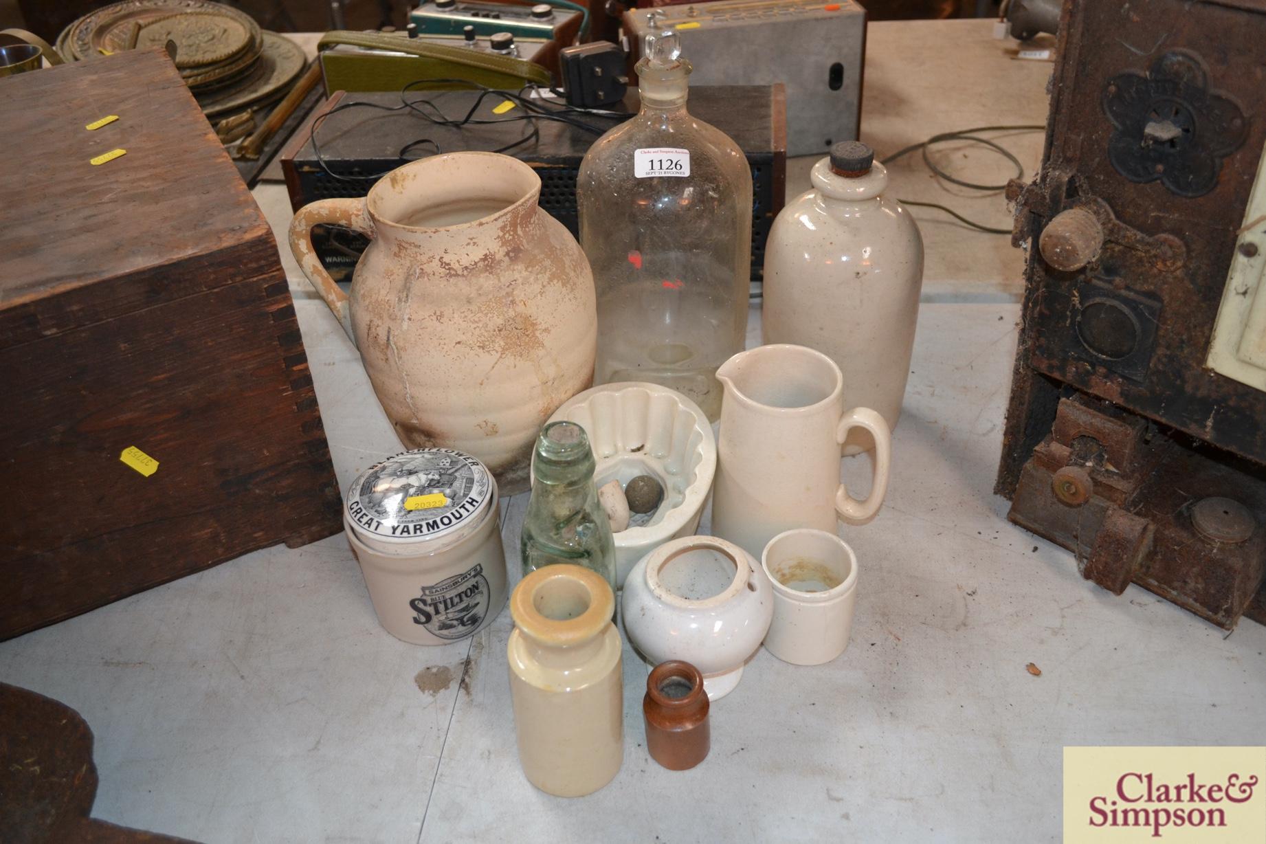A white stone glazed bottle, a white china jelly m