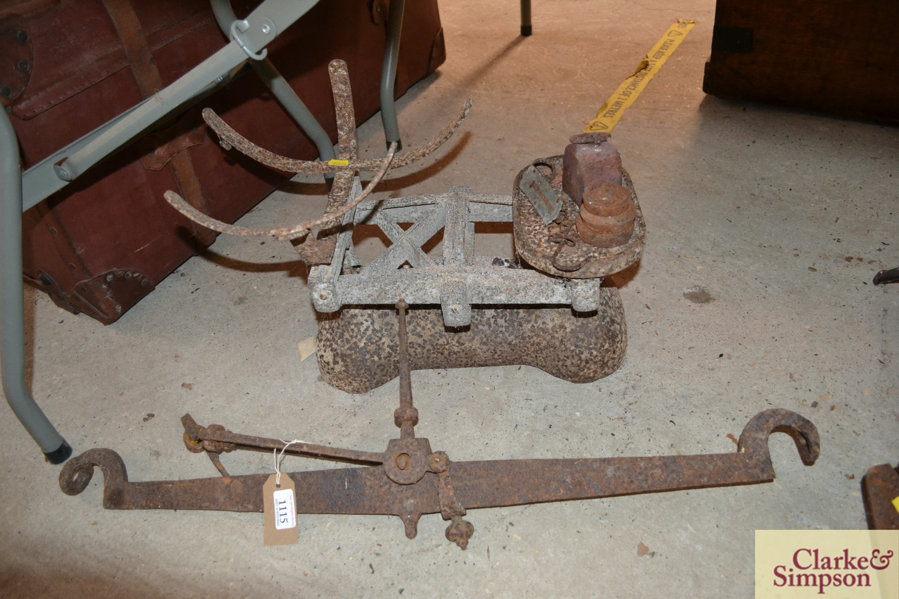 An old cast iron beam scale (incomplete) and a cas