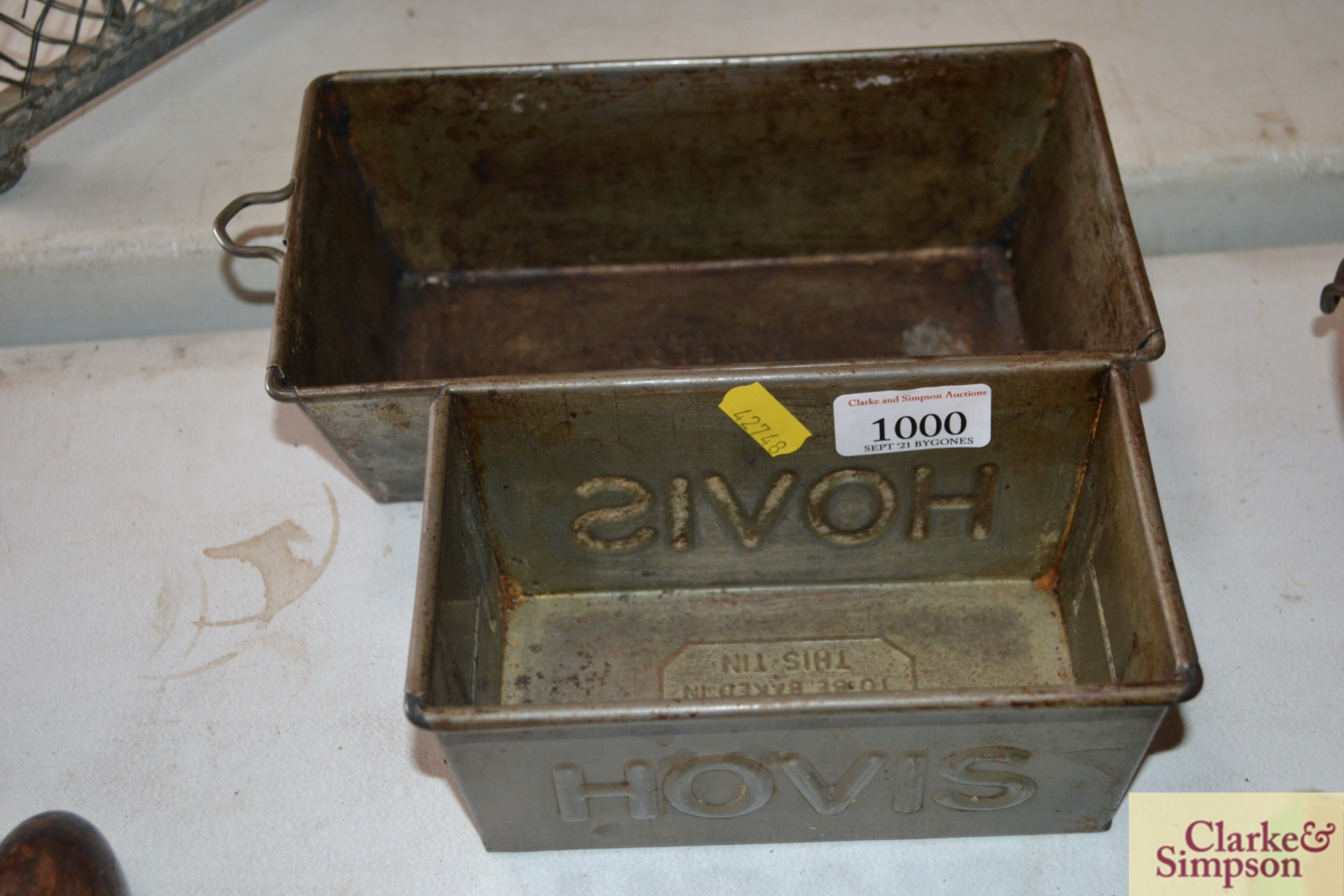 A Hovis and one other metalware bread tins