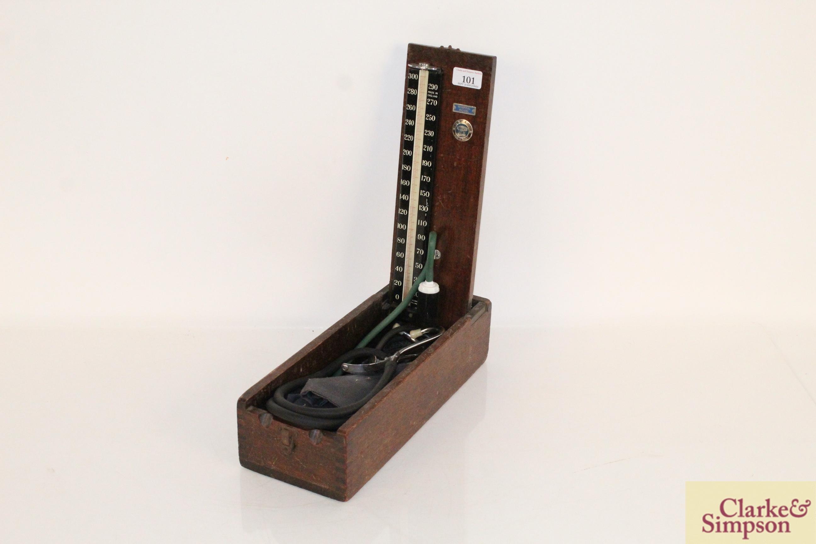 A vintage wooden boxed blood pressure gauge by Accos