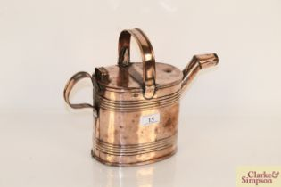 An antique copper Country House watering can