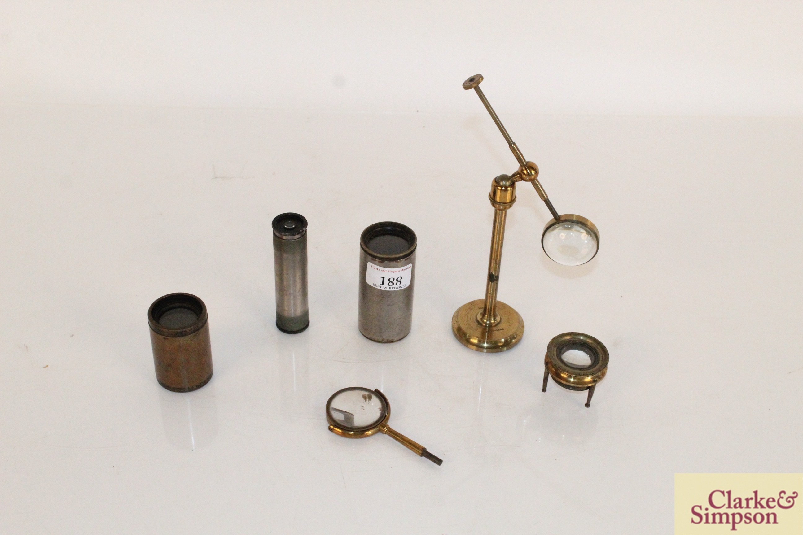 A brass cased magnifier on stand by Dunscombe of B