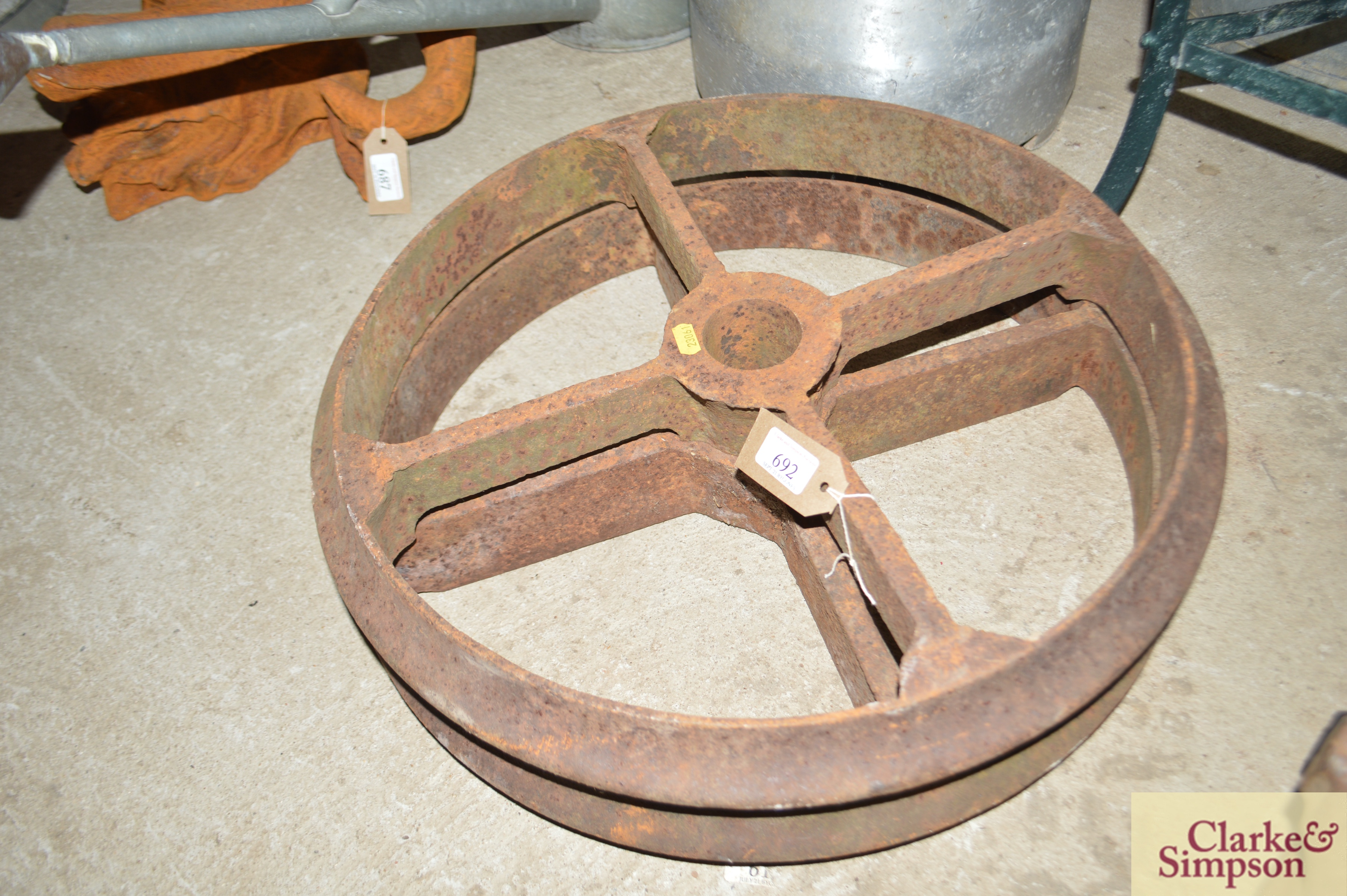 Two cast iron wheels