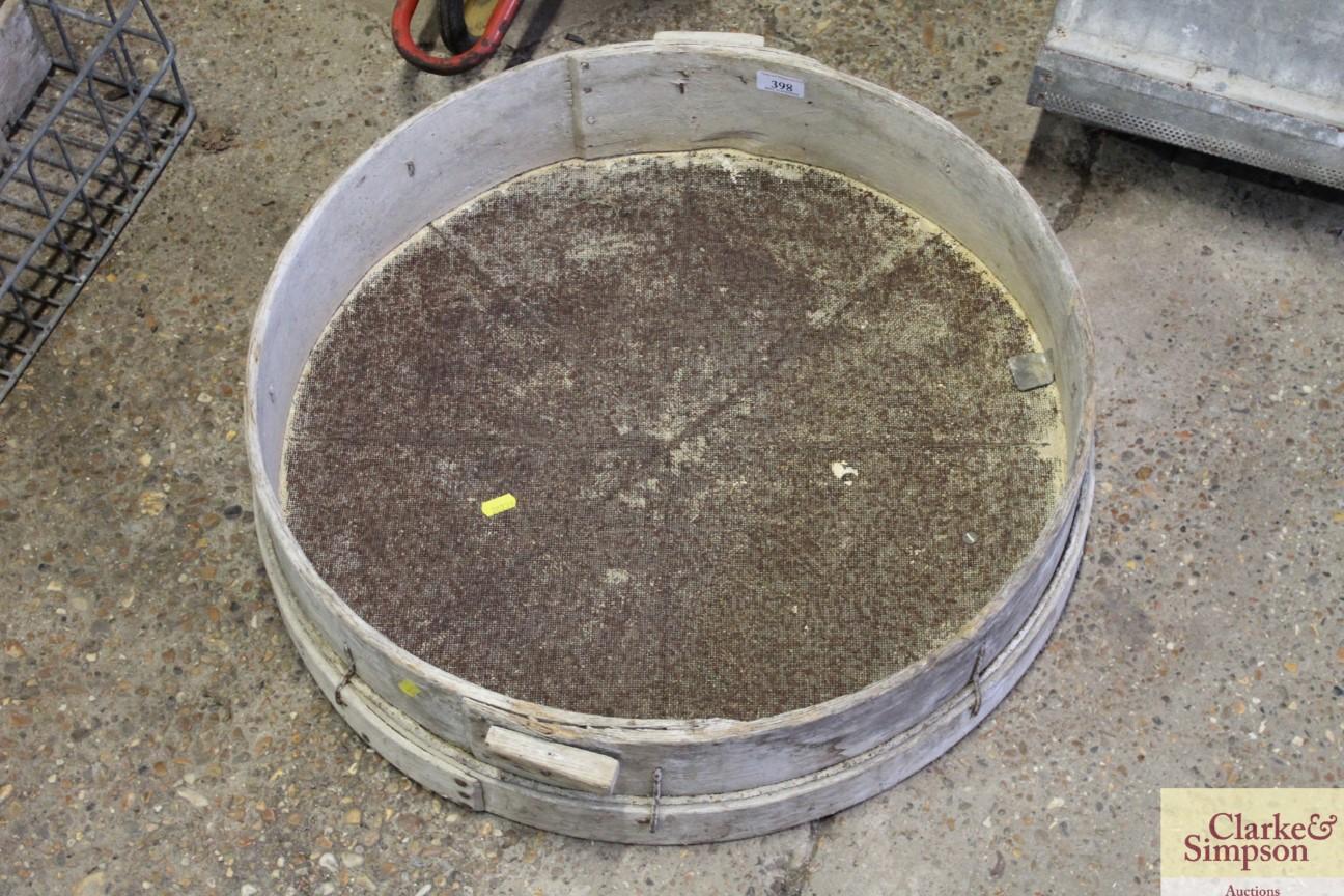 A vintage wooden sieve