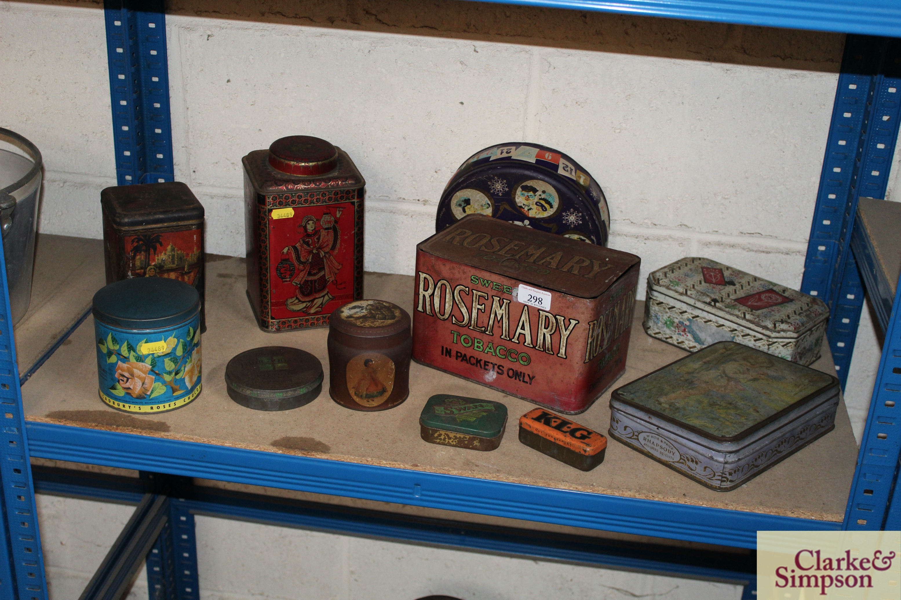 A collection of vintage advertising tins including
