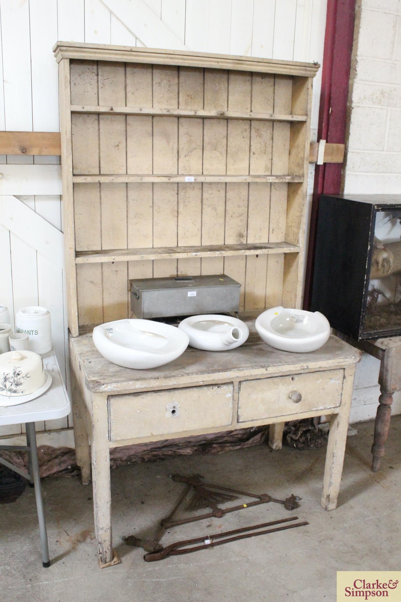 An antique painted pine dresser