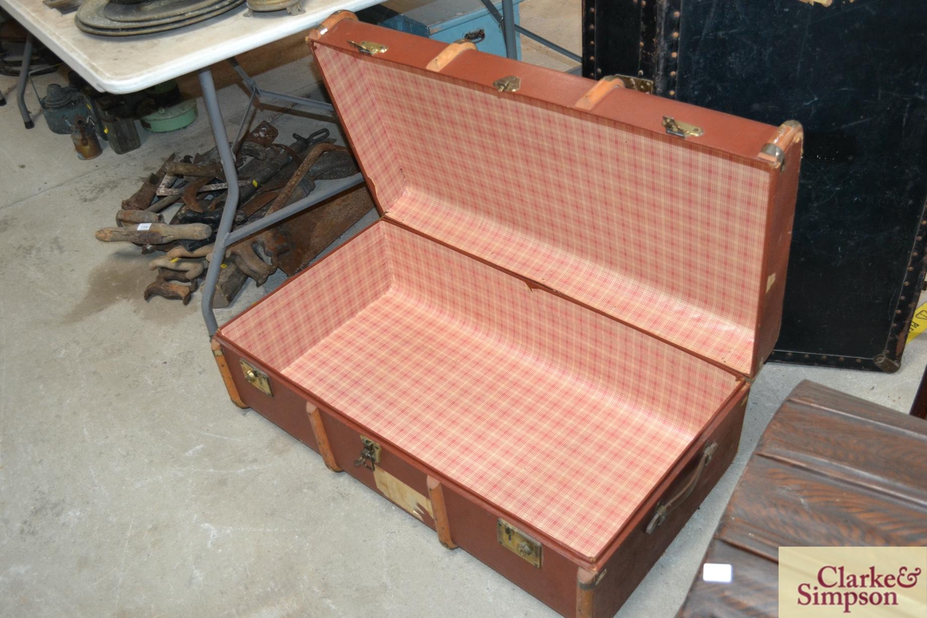 A wooden bound steamer trunk