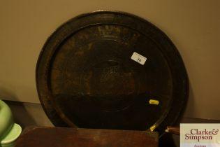 A circular eastern brass tray