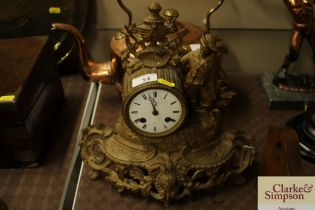 A French gilt metal mantel clock with figural deco