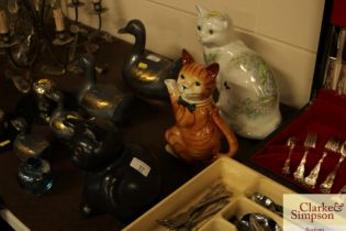 A cat teapot and two other cat ornaments