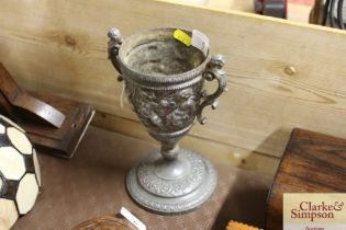A pewter goblet with cherub decoration