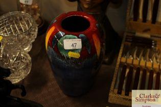 A Poole Pottery multi colour baluster vase