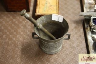 An antique bronze pestle and mortar; dated 1825