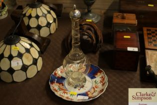 An Imari scalloped border plate and a decanter