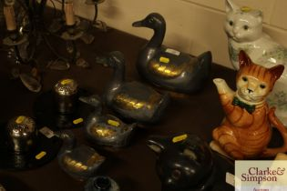 Four graduated pewter and brass duck ornaments