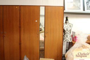 A Meredew mirror fronted two door teak wardrobe