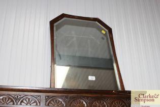 An oak framed bevel edged wall mirror