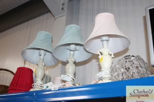 Three table lamps and a quantity of shades, and a