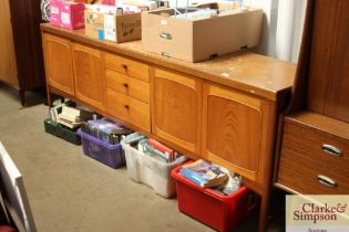 A teak sideboard fitted three central drawers