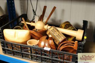 A box containing various wooden items; ramekins et