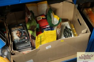 A box containing various books and VHS tapes