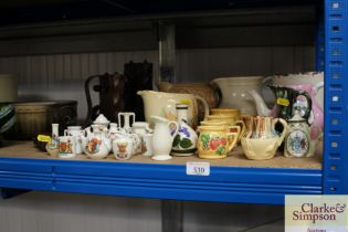 A quantity of various crested china; a jug; booken