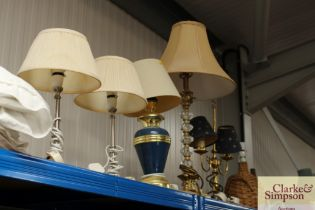 A pair of modern table lamps together with three o