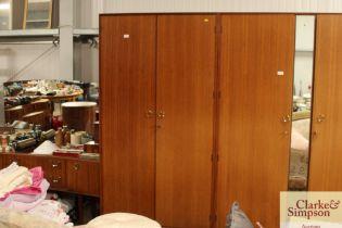 A Meredew two door teak wardrobe