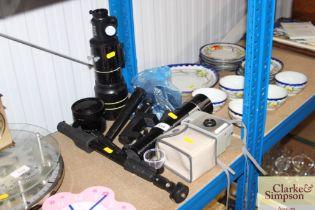A quantity of various camera lenses