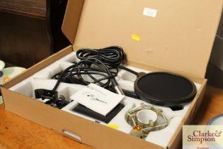 A Toner BM700 microphone in original box
