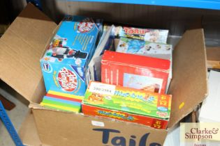 A box of children's games and Tractor Ted DVDs