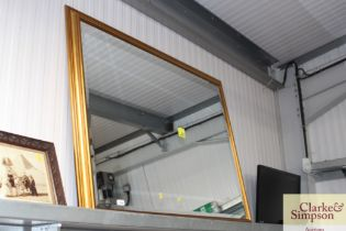 A large bevel edged wall mirror contained in gilt