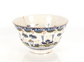 A rare Bristol Delftware polychrome punch bowl, circa 1730, the exterior decorated with four