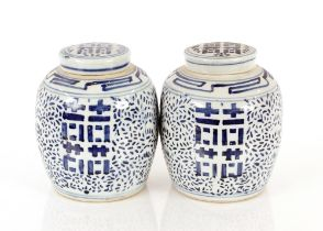 A pair of Chinese blue and white jars and covers,having decoration of stylised flowers and