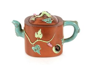 Two Chinese Yixing teapots,having coloured enamel decoration of animals and artefacts; and a