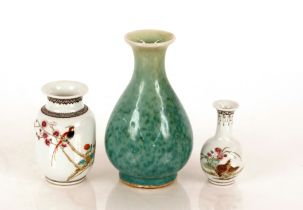 Two Chinese baluster vases,decorated exotic birds and script; and a green glazed oriental