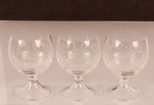 Three glasses decorated with imagesof fish