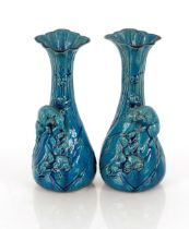 A pair of blue glazed Japanese baluster vases,decorated with rats, 24cm high