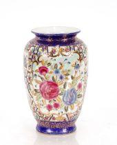 A large Oriental famille rose decorated baluster vase,30cm high