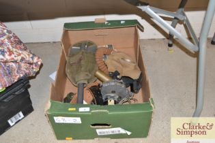 A box of assorted WW2 military equipment
