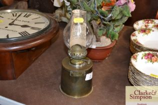 A brass oil lamp by J.W.Searby & Son Lowestoft