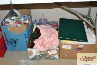 Three boxes of various textiles etc.