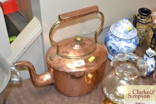 A brass and copper kettle