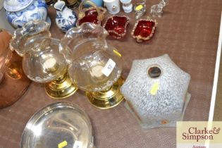 Two glass globe candle holders; and a 1930' glass