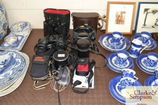 A quantity of cameras and binoculars to include Mi